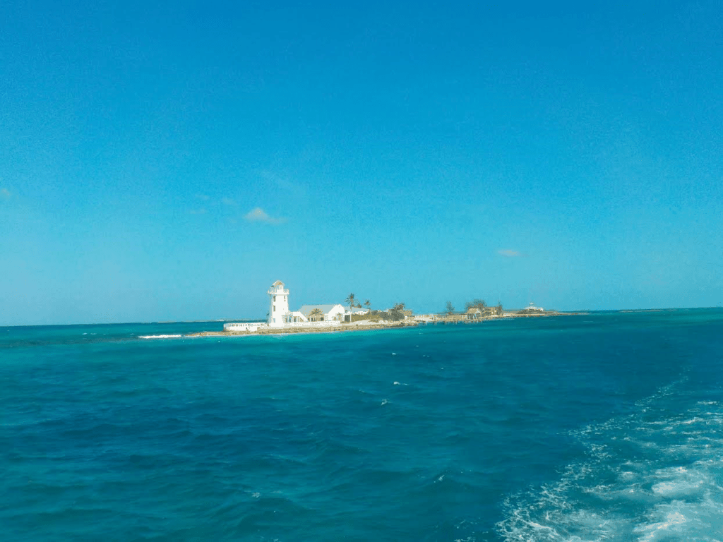 The sliver of land that makes up Pearl Island perches in the blue Caribbean Ocean.