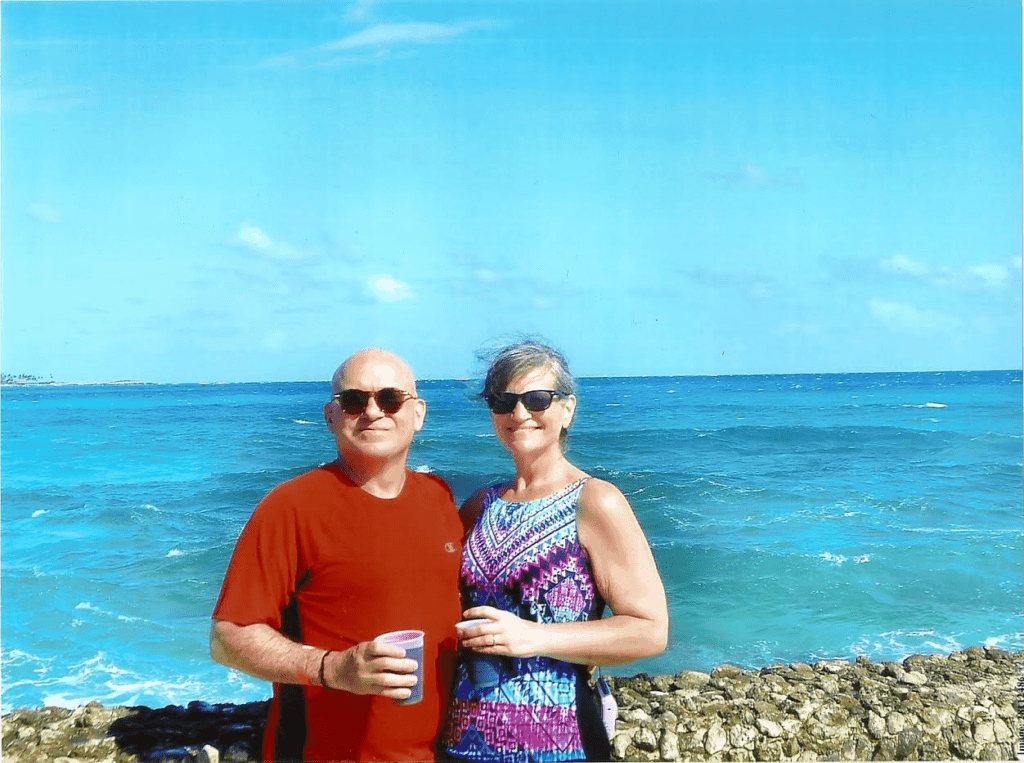 The authors pose for a relaxed selfie, as they sip tropical drinks at Pearl Island.
