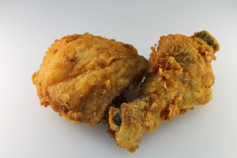 A couple of pieces of fried chicken make the base of a delicious meal.