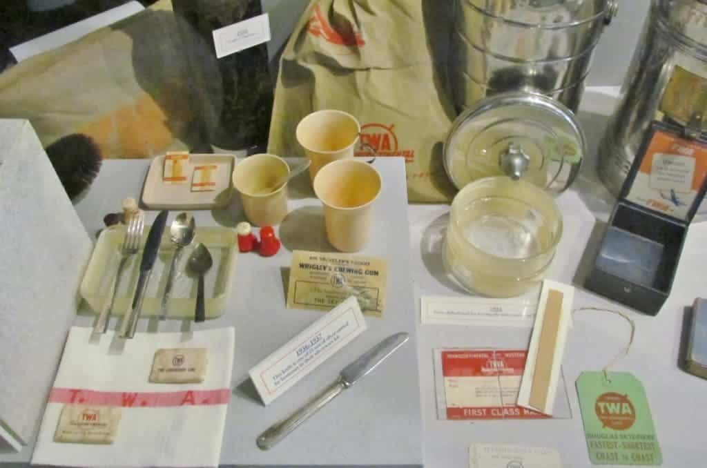 A display shows the normal serving items that would have been used on flights during the 1930's.