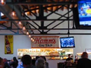 An antique Hamms beer sign hangs above the opening to the kitchen at Third Street Social.