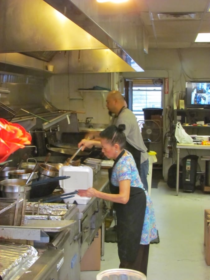 Owners Annie and Alvin prepare menu items in the galley style kitchen.