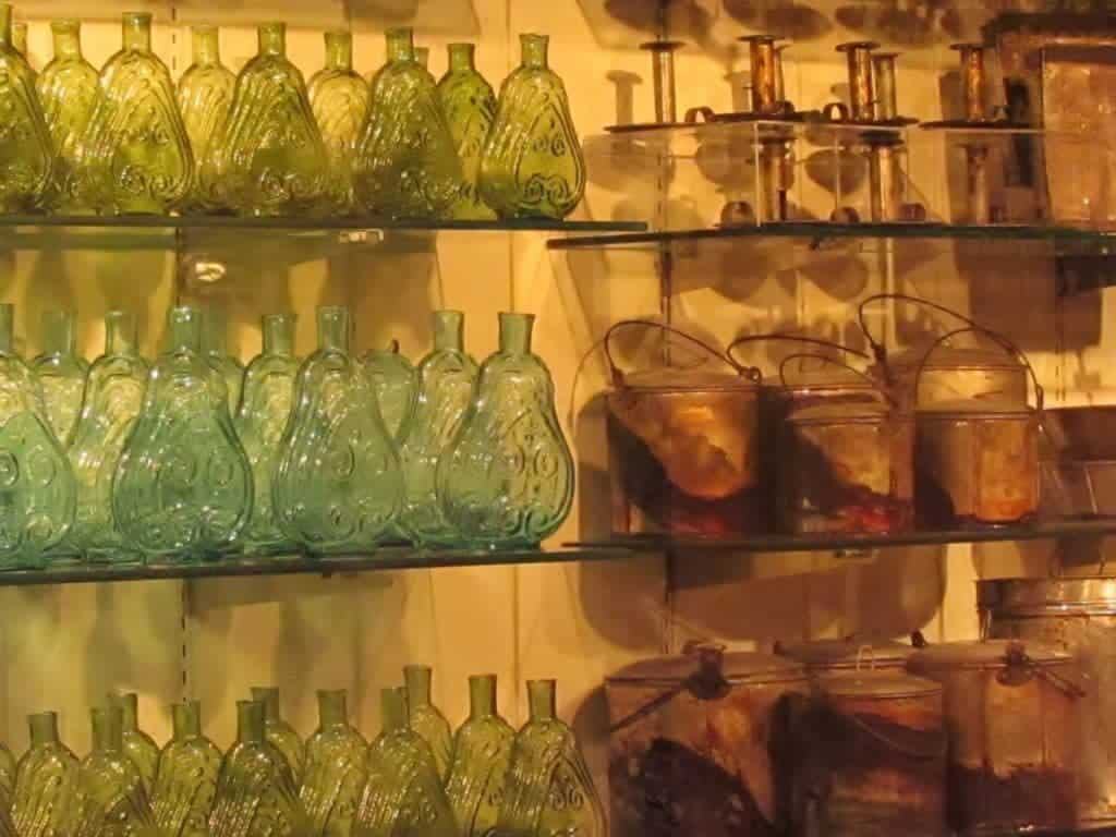 Glass shelves are loaded with collections of various items recovered from the steamboat.
