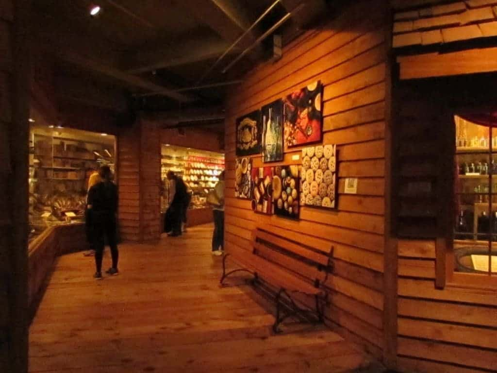 Wooden floors and walls line the display areas in the Arabia Steamboat Museum. A wooden bench offers guests a place to sit and view the collection.