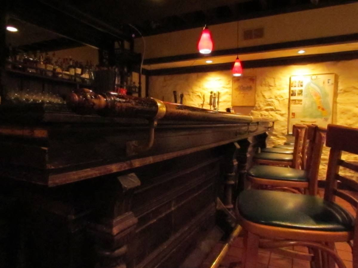 An old wooden bar is part of the scenery at The Majestic Restaurant.