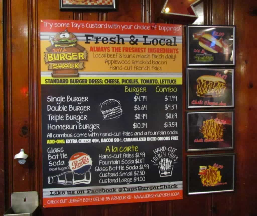 The brightly colored menu at Tay's Burger Shack lists the options available for thier grass fed beef burgers. Side dishes are minimal, but they also feature Nathan's hot dogs.