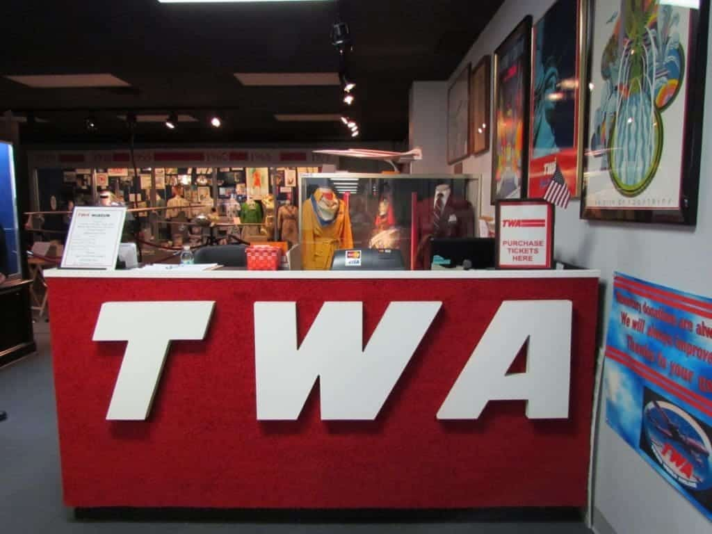 The TWA logo is prevalent on the desk front at the entrance to the TWA Museum.