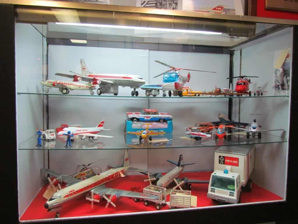 A display case filled with TWA themed toys.