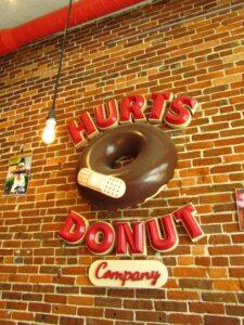 Hurts Donut three dimensional sign.