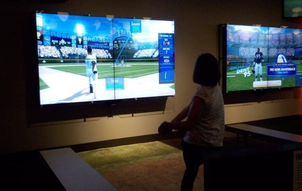 Visitors test their skill at home run derby.