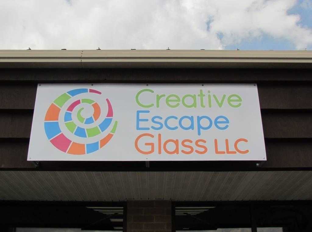 Creative Escape Glass signage.