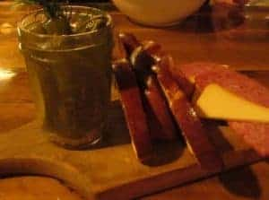 pickles, sausage, and cheese are served with bread.