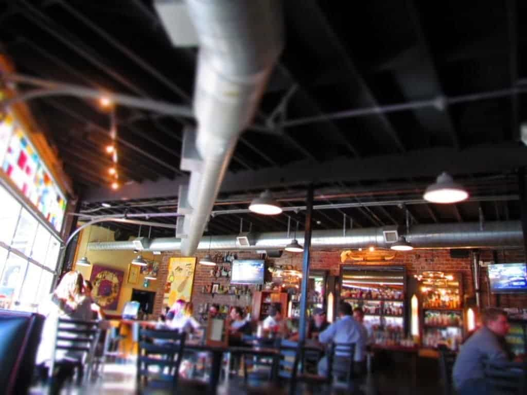 The open and eclectic industrial feel interior at Monarch in Wichita, Kansas.