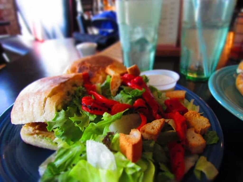 The Chicken Caprese sandwich at Monarch in Wichita pairs well with a fresh salad.