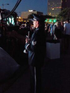 Soldier preparing to play Taps.
