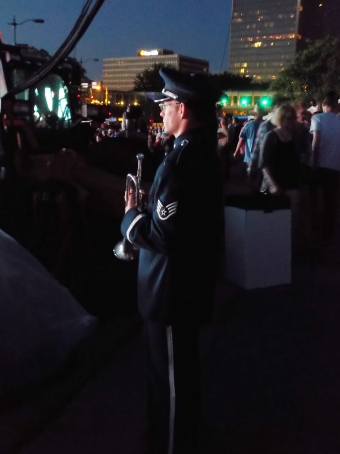 Soldier preparing to play Taps.
