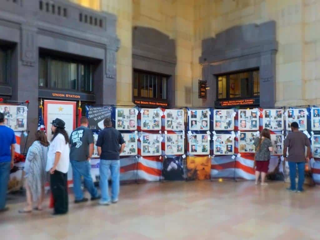 Visitors examine the fallen heroes display