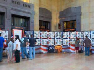 Visitors examine the fallen heroes display