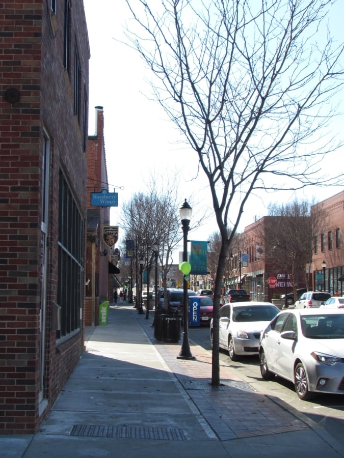 Third Street in downtown Lee's Summit is a two way street with available parking on each side of the street. Brick buildings line the street, and ample sidewalks amke pedestrian travel easily accessible.