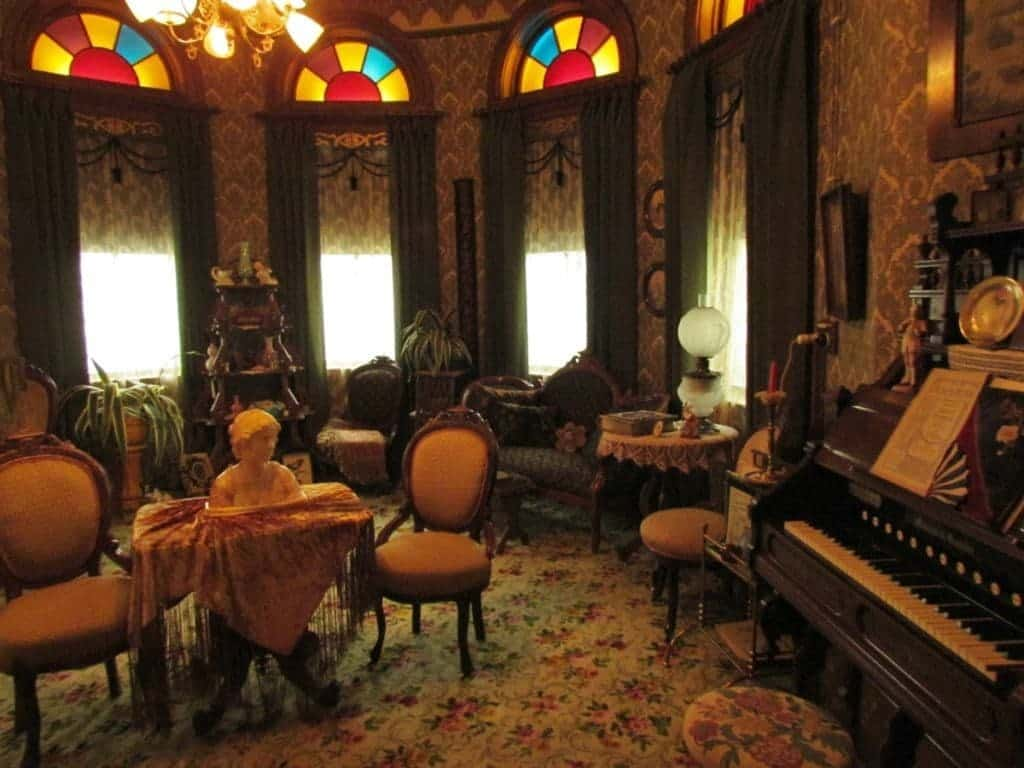 An ornate room exhibits victorian life in early Wichita.