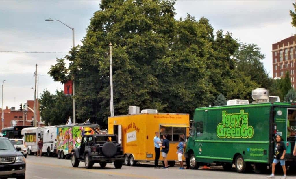 Food trucks line the streets to sell to visitors.