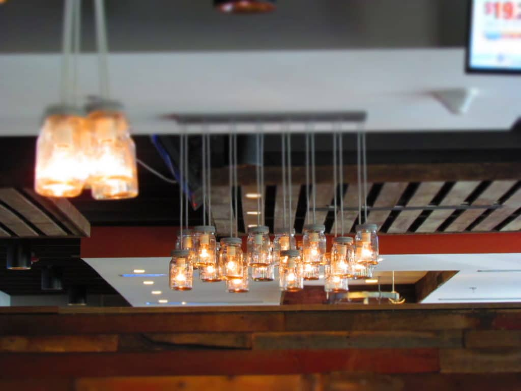 Mason jars are used in the lighting at the signature restaurant in KCK.