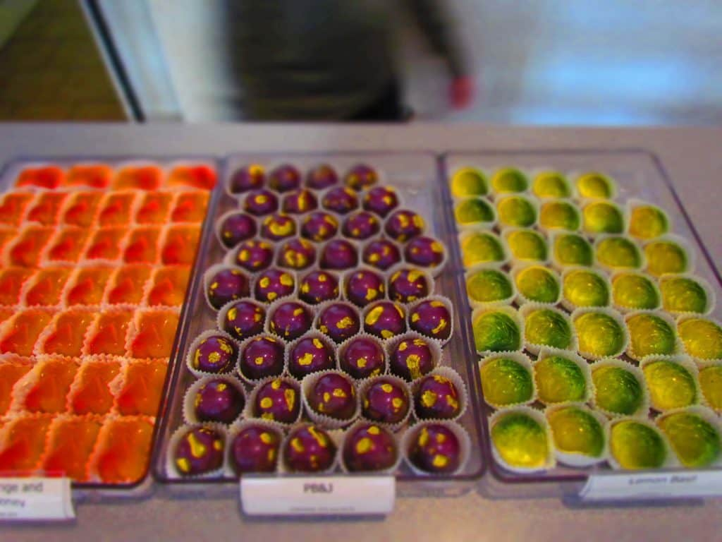 Trays filled with colorful artisan chocolates are found at Glacier Confection.