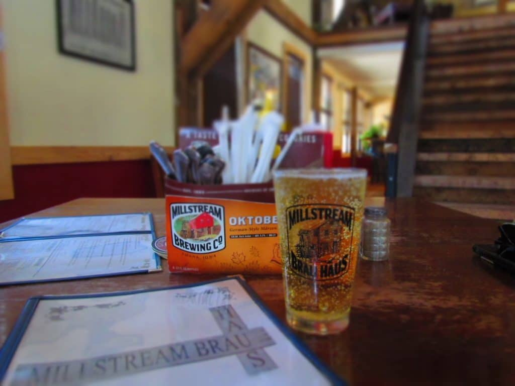 A cold craft glass of brew sits on the hand crafted tables in the dining room of Millstream Brau Haus.