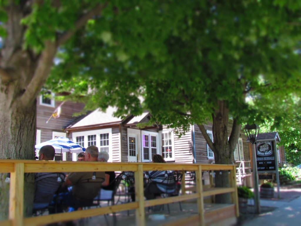 Diners sit casually in the shade on the outdoor patio at Millstream Brau Haus.