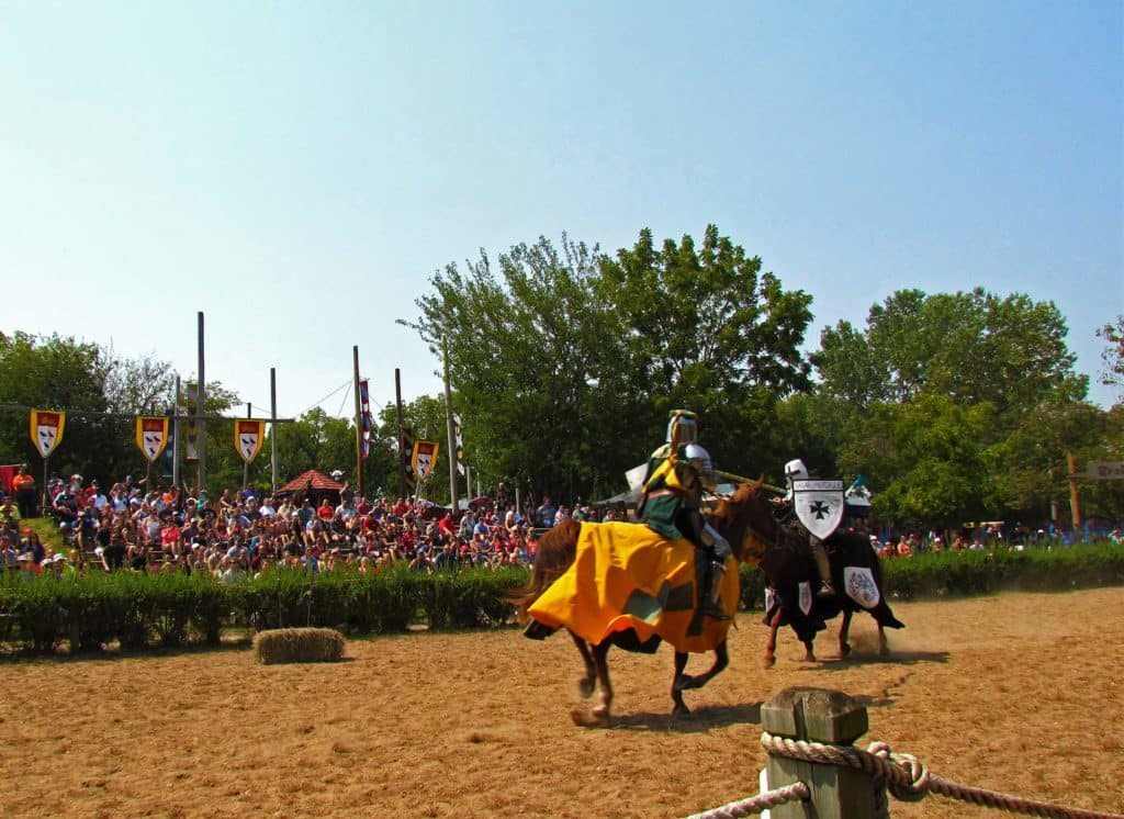 Two knights clash during a jousting match.