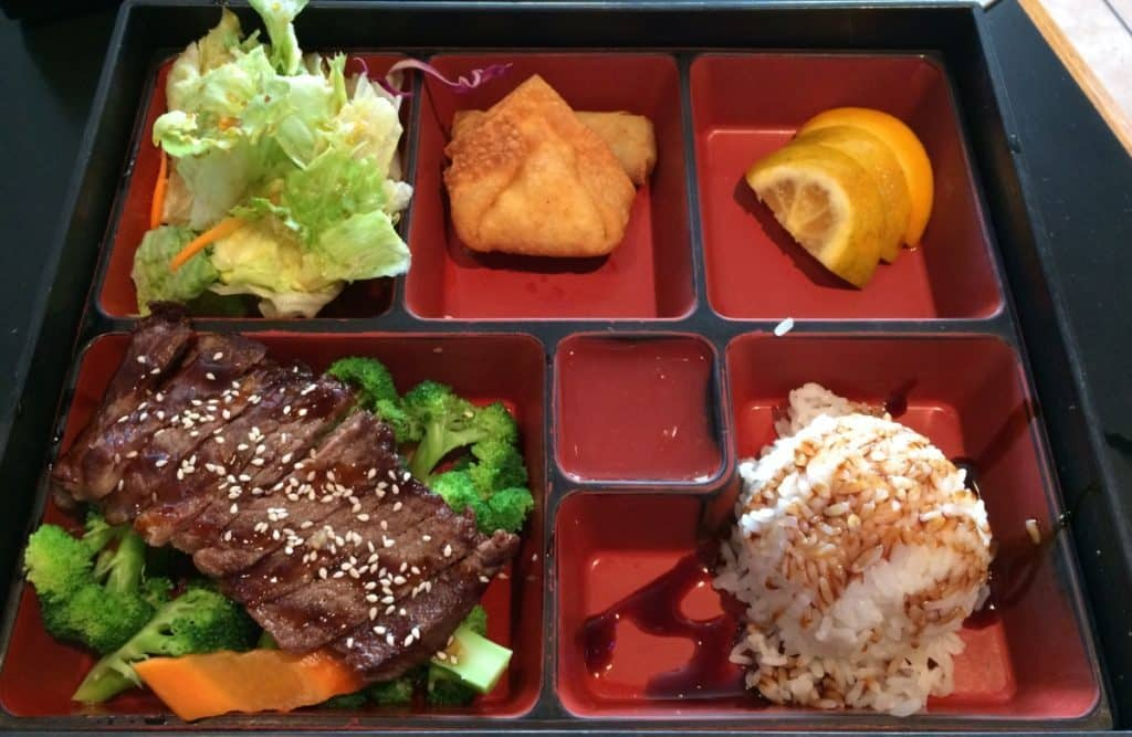 Bento box filled with delicious meal portions featuring Teriyaki Steak.