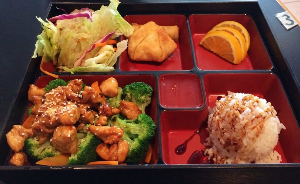 Bento box filled with delicious meal portions featuring Teriyaki Chicken.