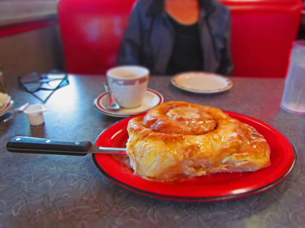 A huge cinnamon roll is a mainstay to Tally's Cafe.
