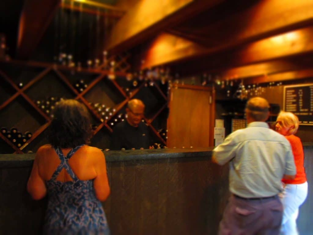 The owner serves visitors samples of their wine selection in a very unassuming fashion.