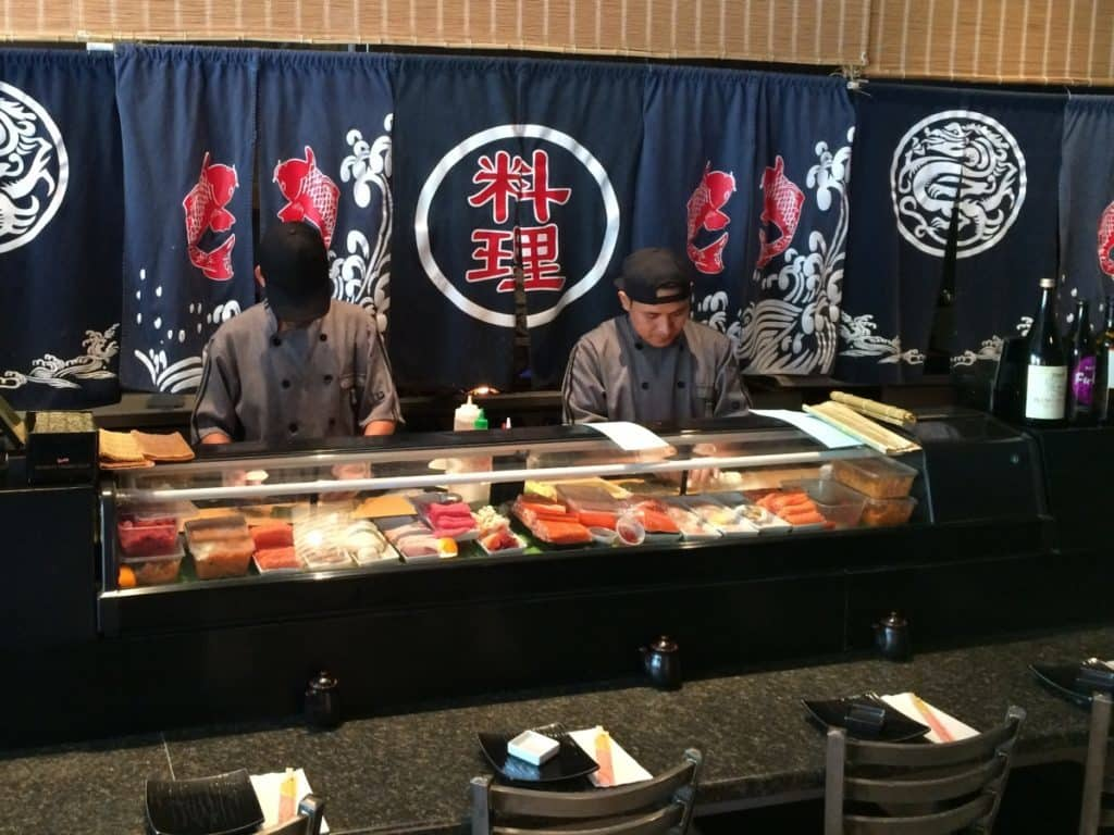 Sushi makers ply their craft at the sushi bar counter in Friends Sushi and Bento.