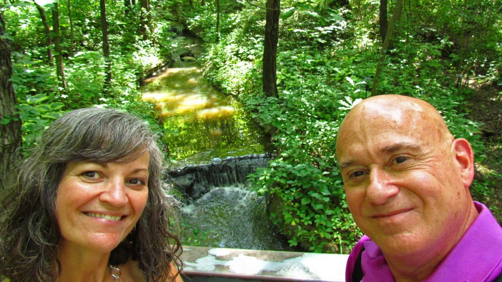 The authors pose for a selfie on front of one of the waterfalls found on the grounds of Powell Gardens.