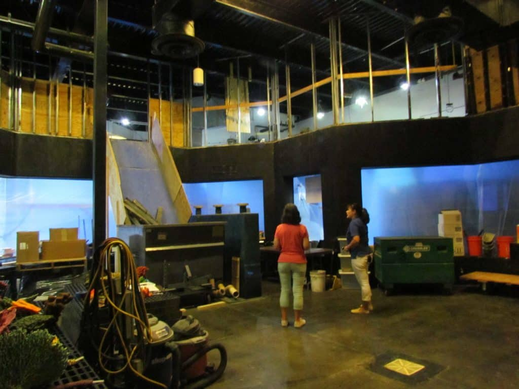 The author visits an upcoming exhibit area with Teri Bowers from the Oklahoma Aquarium.