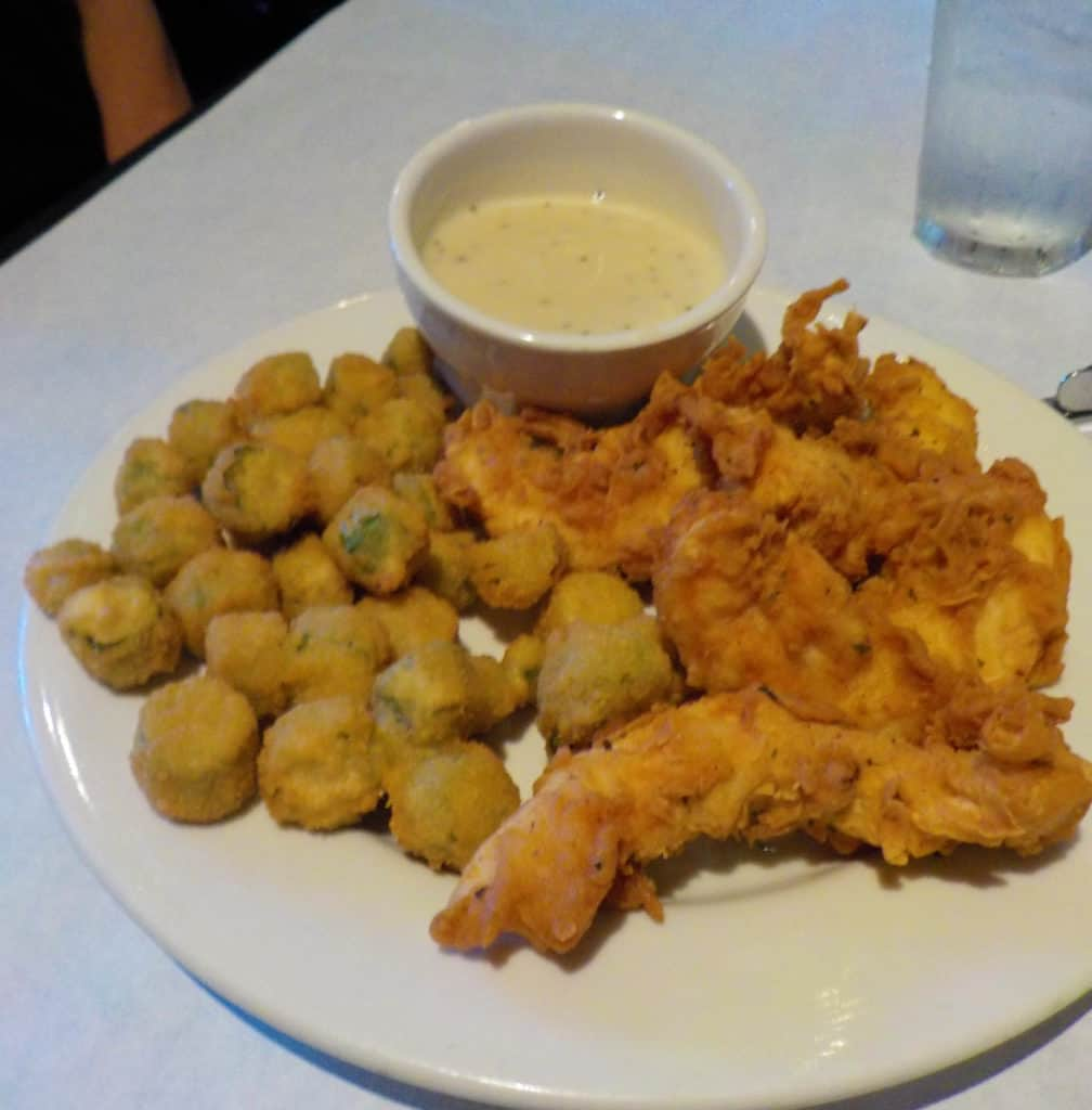 Crispy Chicken Tenders are served with a side order of fried okra.