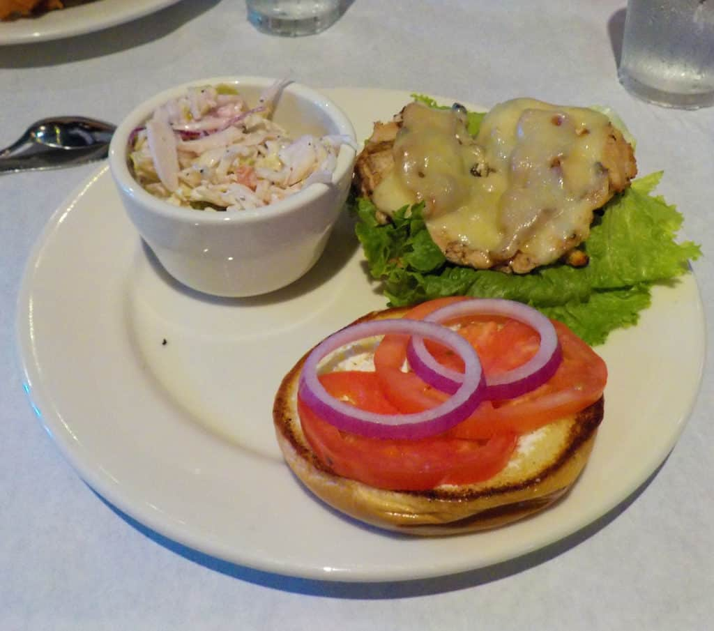 A Chowhouse Chicken Sandwich is served with a side order of cole slaw.