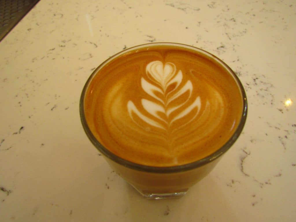 An artistic design adorns a coffee drink.