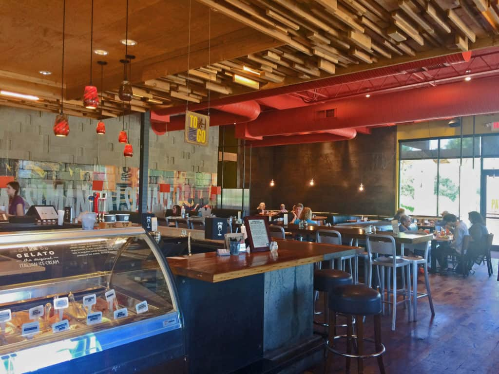 Spin Pizza features an airy and open dining area that feels comfortable and inviting.