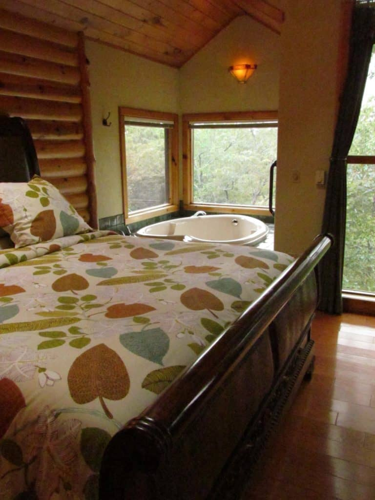 A heart shaped Jacuzzi tub offers a great spot to view the forest that surrounds the Treehouse Cottages.