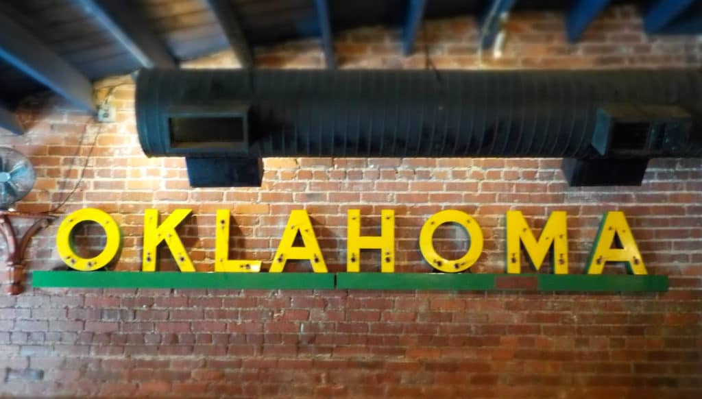 The brick walls are a great backdrop for the yellow metal letters that spell out Oklahoma.