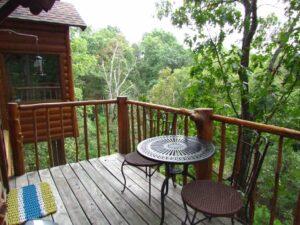 A bistro set makes enjoying the raised deck a breeze.