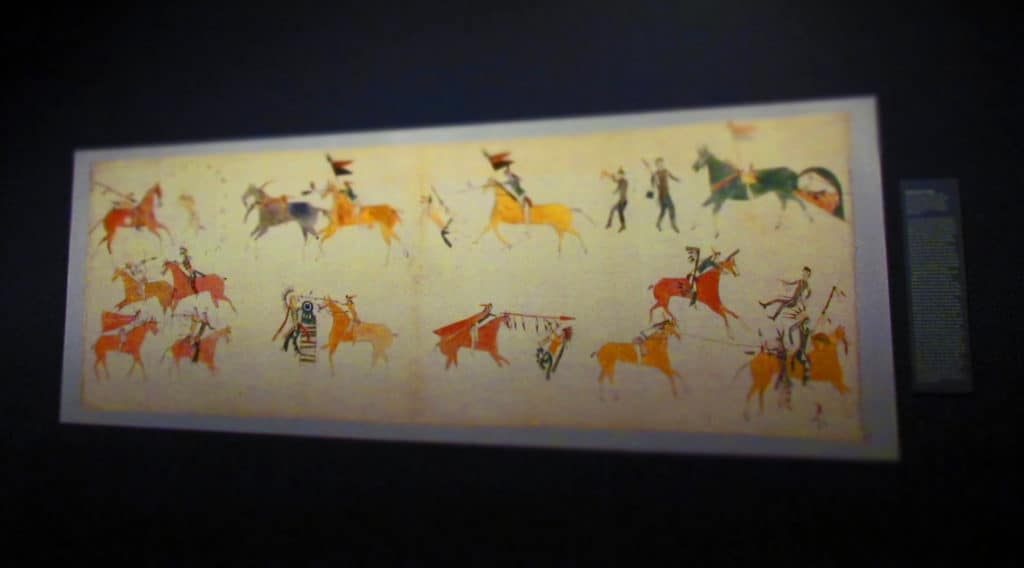 A native American pictograph shows a battle between tribes.
