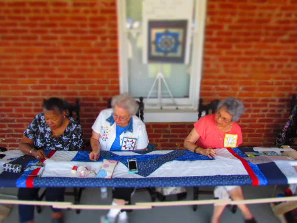 Members of the Grinter Quilting Bee work on a project.