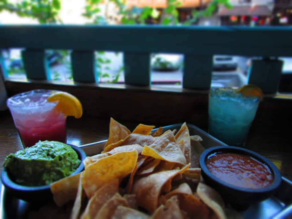Fresh tortilla chips are served with guacamole and salsa, as well as two varieties of margaritas.