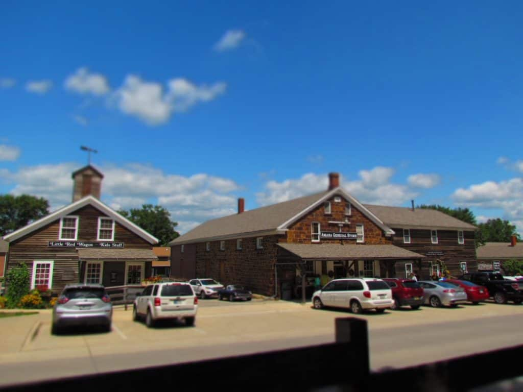 A view of a few of the plain wooden buildings that occupy the Amana Colonies.