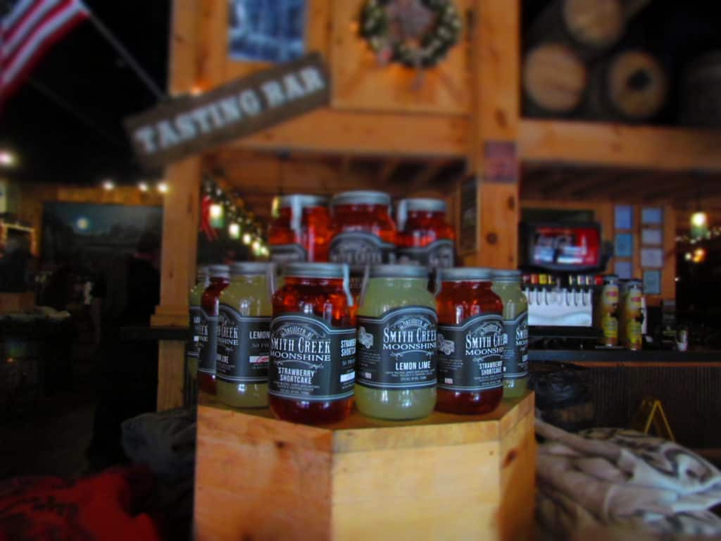 A display of moonshine shows potential flavor mixes.