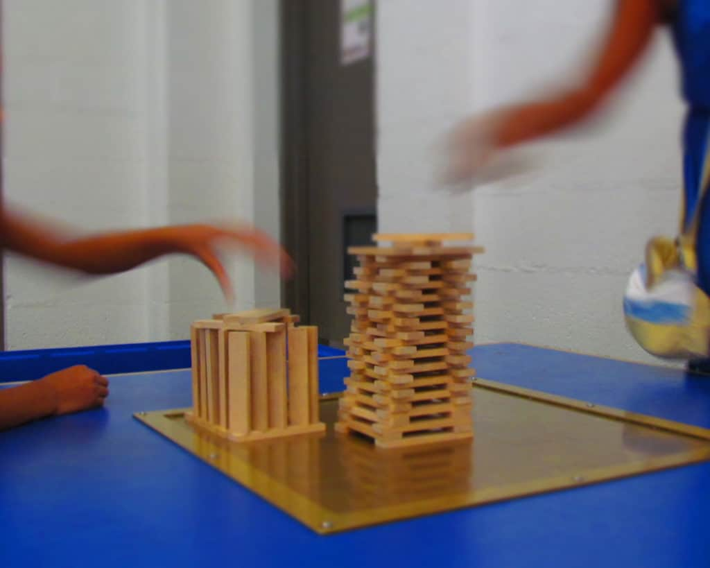 Guests try their hand at constructing buildings that can withstand a simulated earthquake.
